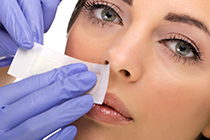 woman reciving facial epilation services at illuminari medspa agoura hills ca