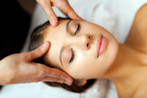 Woman enjoing a facial massage